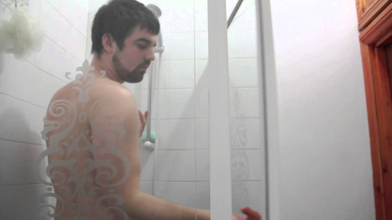 Naked guy getting in shower