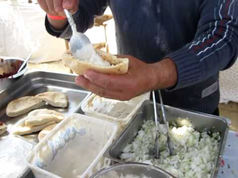Bino Gabso from Dr. Shakshuka preparing Shawarma