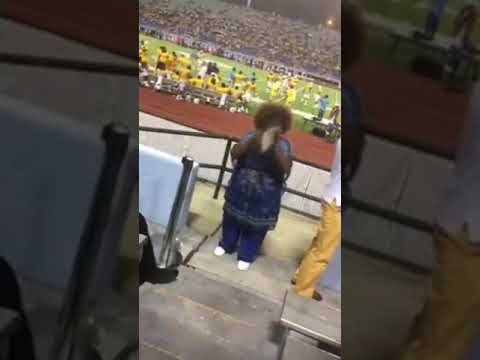 Woman plays a mean tambourine at an HBCU game More Tambourine Marching band