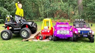 Thomas and Elis ride on toy monster truck and jumps over the cars for kids