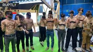 Extinction Rebellion activists strip at protest against 'Greenwashing' at COP25