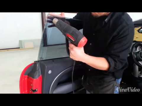 how to clean tint glue from window