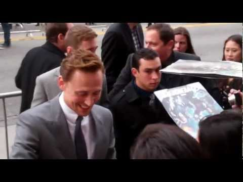 Tom Hiddleston gets a mysterious gift from fans at Marvel's 'The Avengers' Premiere