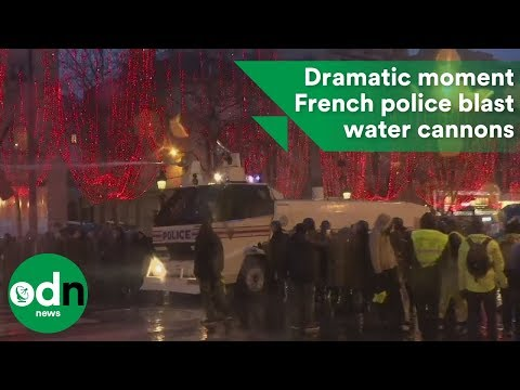 Dramatic moment French police blast water cannons