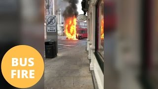 Repeat youtube video Double decker bus bursts into flames in the middle of a town centre