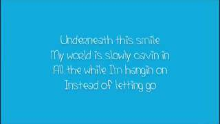 Underneath this smile lyrics