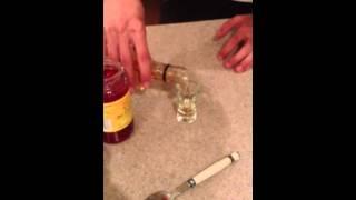 Rum, Cherry juice, and Hemp seed oil shot