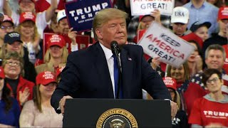 Trump rallies supporters as Dems debate in Iowa