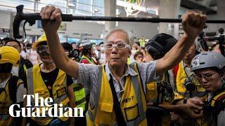 Uncle Wong, 82: protecting Hong Kong protesters with his walking stick