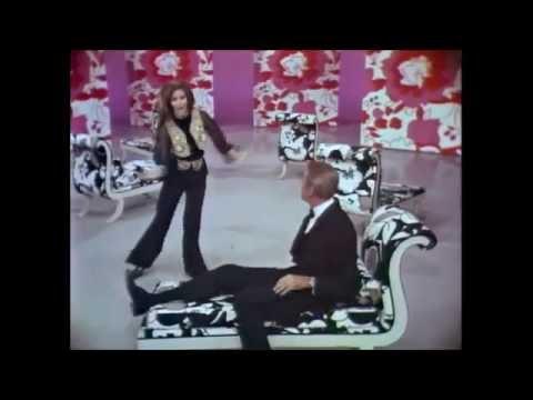Raquel Welch & Jimmy Stewart flirting