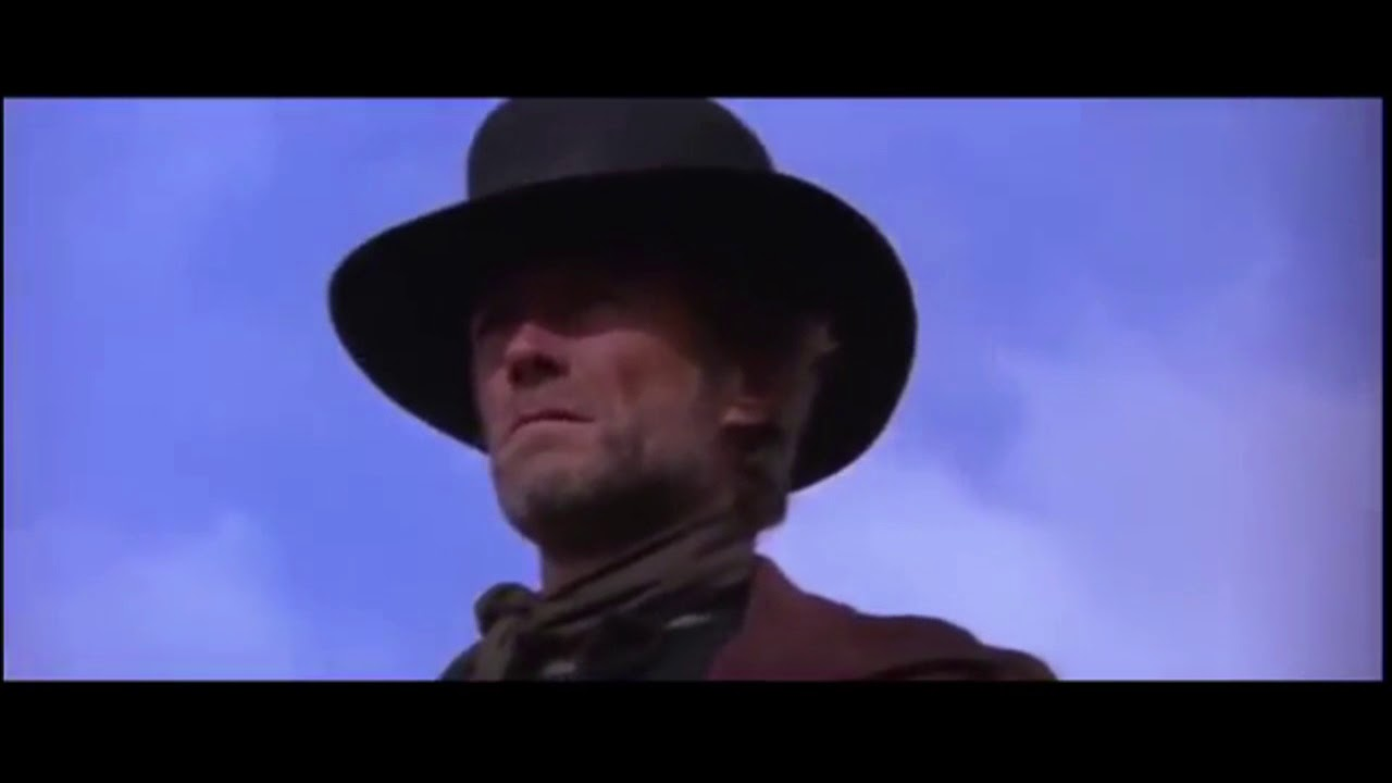 scene from pale rider showing the remington 1858 cylinder change