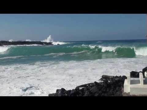 Large surf breaking across the Honokohau Harbor entrance.