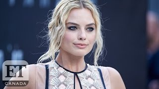 Margot Robbie Falls On Stage While Promoting 'Suicide Squad' In Toronto