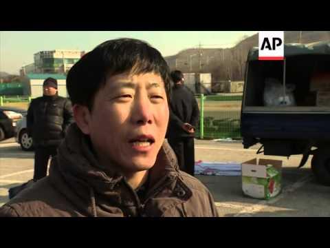 North Korean dissidents distribute propaganda leaflets near the border