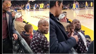 Most Awkward Handshake Ever! Manny Pacquiao Runs Up On Floyd Mayweather At Lakers Game