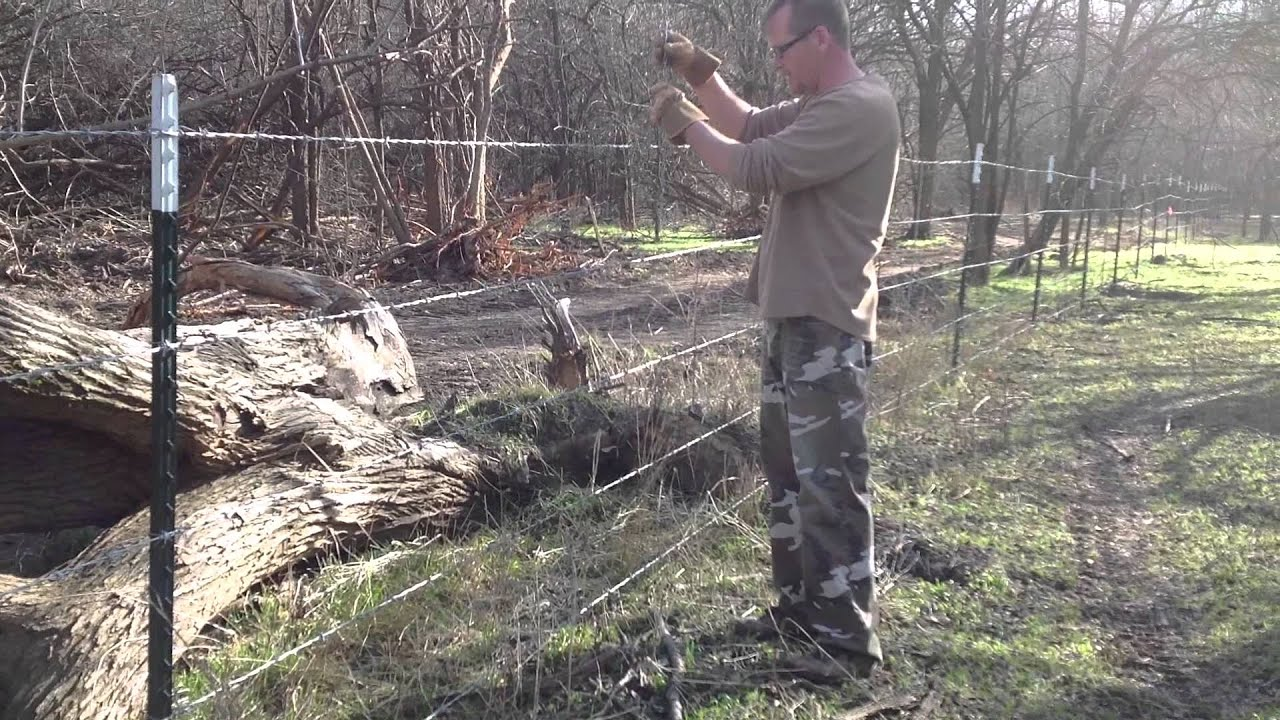 How To Install Fence Stays On Barbed Wire - YouTube