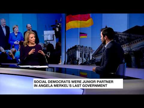 German Social Democrats are divided over governing with Merkel once more