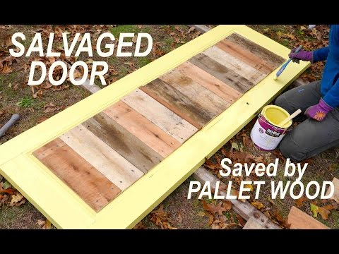 An old salvaged door brought life with pallet wood for for What to make out of those old wood pallets