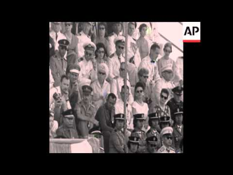 CAN 004 PRESIDENT SUKARNO OF INDONESIA REVIEWS MILITARY PARADE IN JAKARTA ON ARMED FORCES DAY