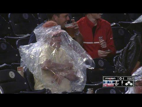Nats fan struggles to put on rain poncho