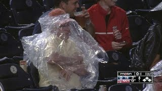 Nats fan struggles to put on rain poncho