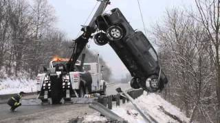 Truck retieved after crashing over hillside