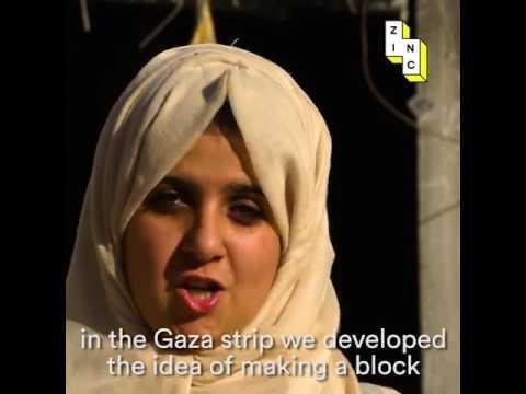 Palestinian girl is turning ash into bricks.Gaza