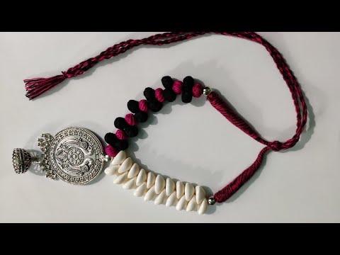 Kori necklace with antique locket, jumka & cotton beads 🙂