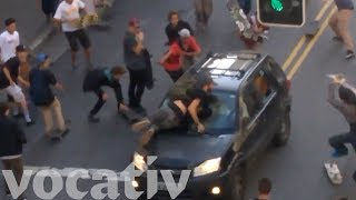 SUV Drives Through Crowd Of Skateboarders