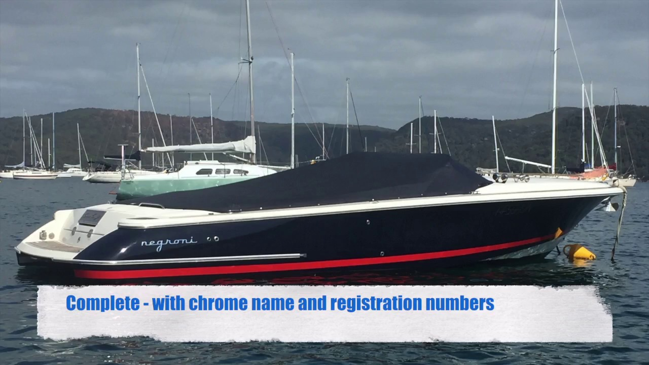 Vinyl Hull Boat Wrap - Chris Craft 28 in Deep Blue with Red Pinstripes and Chrome name