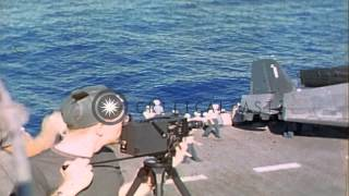 Navy enlisted men in ranks, march to the bow of the USS Shangri-La and officer lo...HD Stock Footage