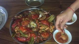 Snack in Asia, Steaming crabs eating with pepper and salt sauce and spicy sauces