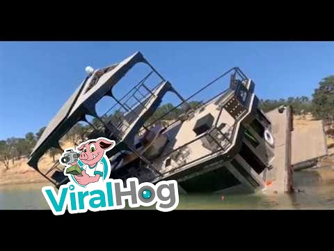 Large Boat Tips and Sinks Near Shore || ViralHog