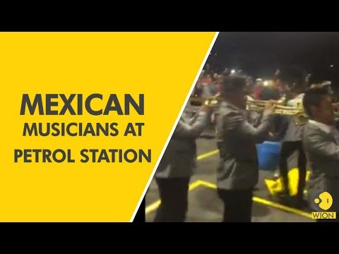 Mexican musicians play at petrol station amidst fuel shortages