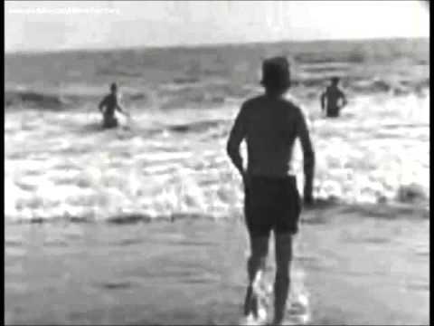 August 19, 1962 - President John F. Kennedy takes a swim at the beach in Santa Monica, CA.