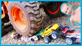 Crushing RC Cars With a Tractor!