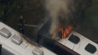Raw: Tour Bus on Fire in Philadelphia