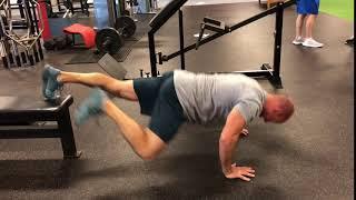 EricCressey.com: Feet-Elevated Spiderman Yoga Push-up