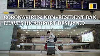 Coronavirus: ban on non-residents leaves Hong Kong airport virtually deserted