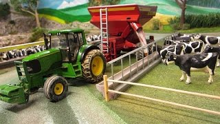 Rc Tractor with farm machinery feeding Cows outdoor - John Deere & heavy machinery in action