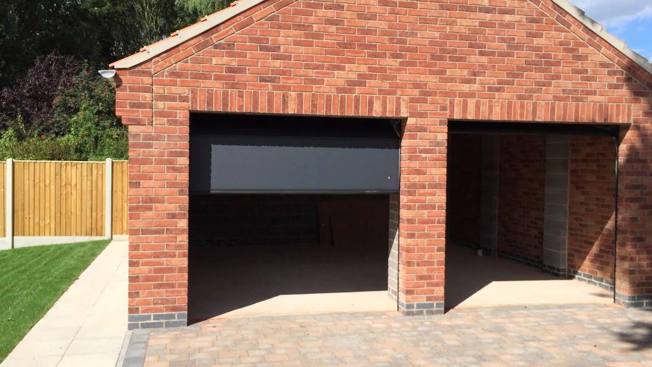 Sectional garage door - Byron Doors Ryterna Sectional Garage Doors And Matching Garage Side Door