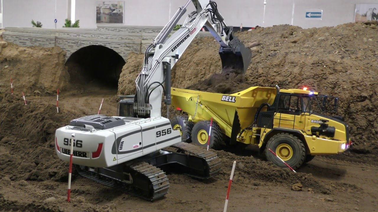 Liebherr 956 loads Volvo A40F and Bell B40D with hard soil