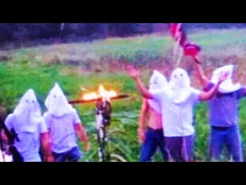 Football Team Burns Cross While Wearing KKK Hoods