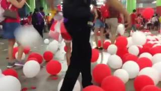 Crowd bursting balloons while leaving NDP 2016