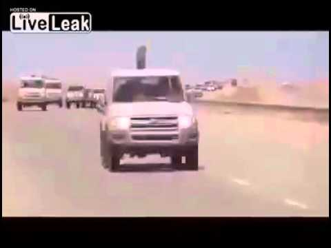 United States Apache attack helicopter following behind ISIS convoy into Syria from Iraq