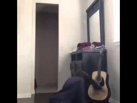 Girl whips hair on guitar