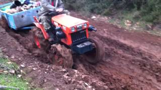 Repeat youtube video Kubota B7001 4x4 in way through a lot of mud!!! INCREDIBLE !!!