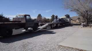 1957 Chevy 4400 Dump Truck driving onto flatbed trailer going to Port of Los Angeles