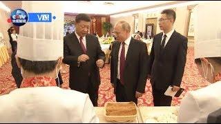 Владимир Путин приготовил традиционное китайское лакомство гоубули и блины [Age 0+]