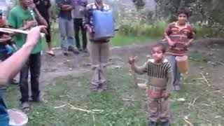 Kids playing music by their awn made instruments